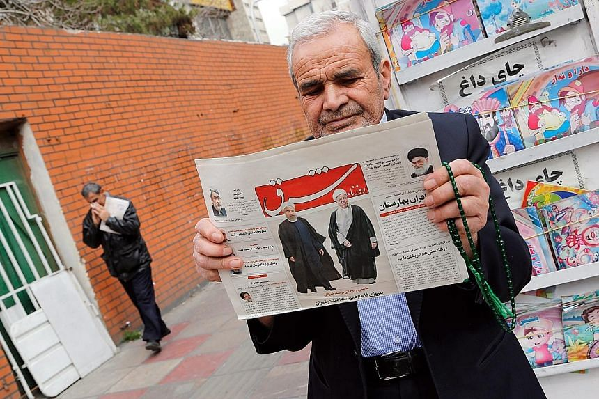 """The Shargh newspaper with the headline reading """"Decisive victory for the reformists"""". The pro-Rouhani coalition is on course to wipe out its conservative rivals in Teheran."""