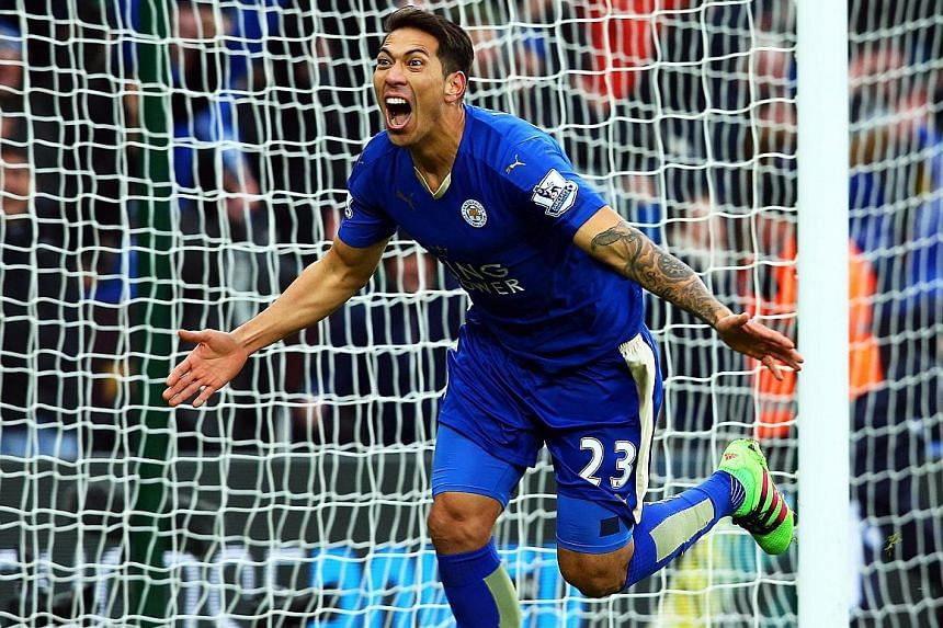 Leicester City's Leonard Ulloa roars in joy after netting their late winner against Norwich City on Saturday. The victory ensured that the Foxes remained top of the English Premier League regardless of the results of their nearest challengers Tottenh