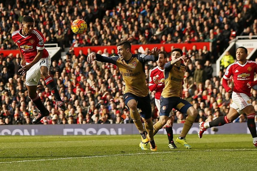 Manchester United's latest scoring sensation Marcus Rashford (left) heads home his second goal against Arsenal. The 18-year-old has scored four goals in the Red Devils' past two matches.