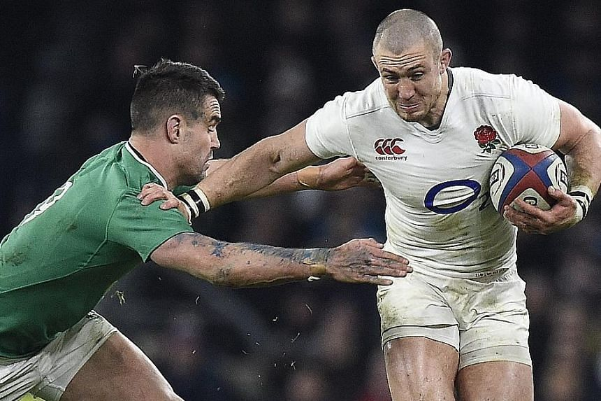 England's Mike Brown (right) being tackled by Ireland's Conor Murray during their Six Nations encounter on Saturday. England won comprehensively to move closer to a Six Nations clean sweep.