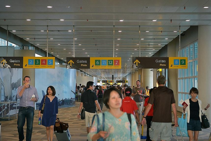 Passengers at Ngurah Rai International Airport in Bali. The Indonesian island is planning to increase its airport capacity by building a second airport in the less-developed north.