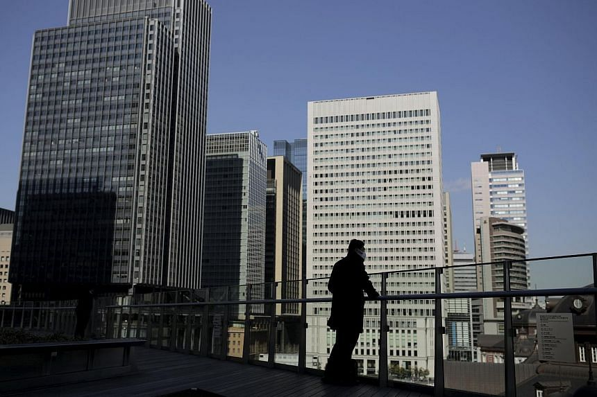 A banking district in Tokyo, Japan, where negative interest rates are now a fact of life. In Singapore, however, interest rates have been inching higher rather than sinking below zero.