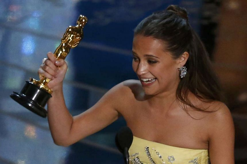 Alicia Vikander receiving the Oscar for Best Supporting Actress for her role in The Danish Girl at the 88th Academy Awards in Hollywood, California on Feb 28, 2016.