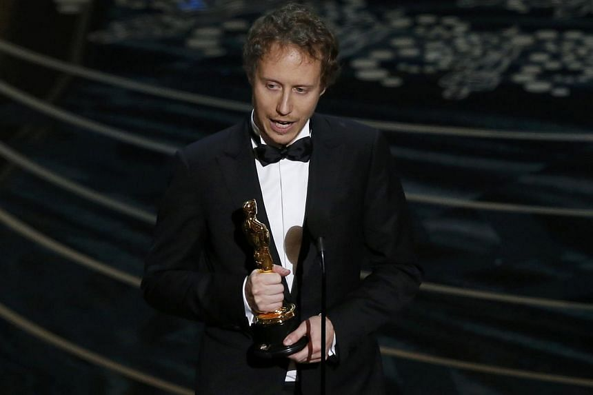 Director Laszlo Nemes of Hungary holding his Oscar for the Best Foreign Film for his movie Son Of Saul at the 88th Academy Awards on Feb 28, 2016.