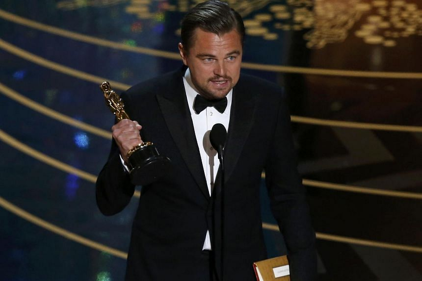 Leonardo DiCaprio holds the Oscar for Best Actor for the movie The Revenant at the 88th Academy Awards.