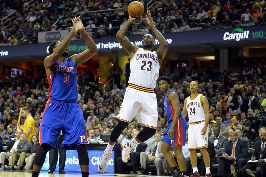 Cleveland Cavaliers forward LeBron James (centre) shoots against Detroit Pistons center Andre Drummond (left) at Quicken Loans Arena.