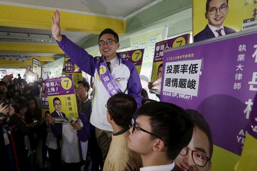 Alvin Yeung (centre) waves at a campaign rally in Hong Kong on Sunday.