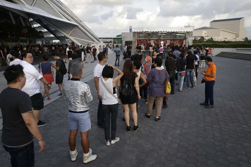 Fans line up before Madonna's first-ever concert in Singapore.