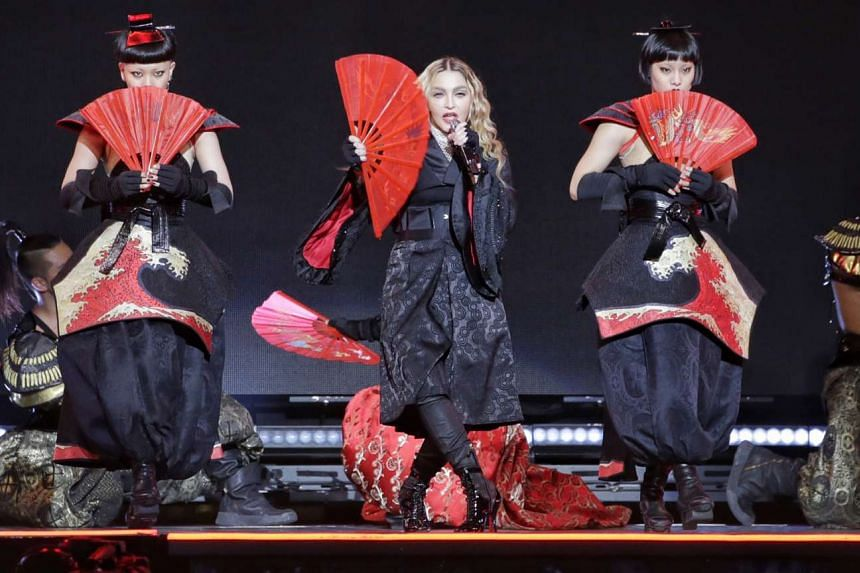 Pop superstar Madonna adds a decidedly Asian edge in her first concert in Singapore on Sunday night (Feb 28).