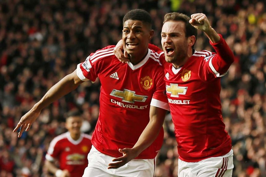 Manchester United's Marcus Rashford celebrates scoring their first goal with Juan Mata.