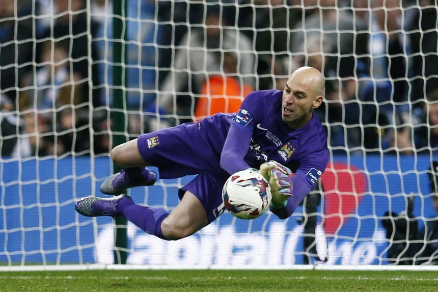 Manchester City's Willy Caballero saves a penalty taken by Liverpool's Philippe Coutinho (not pictured) during the penalty shootout.