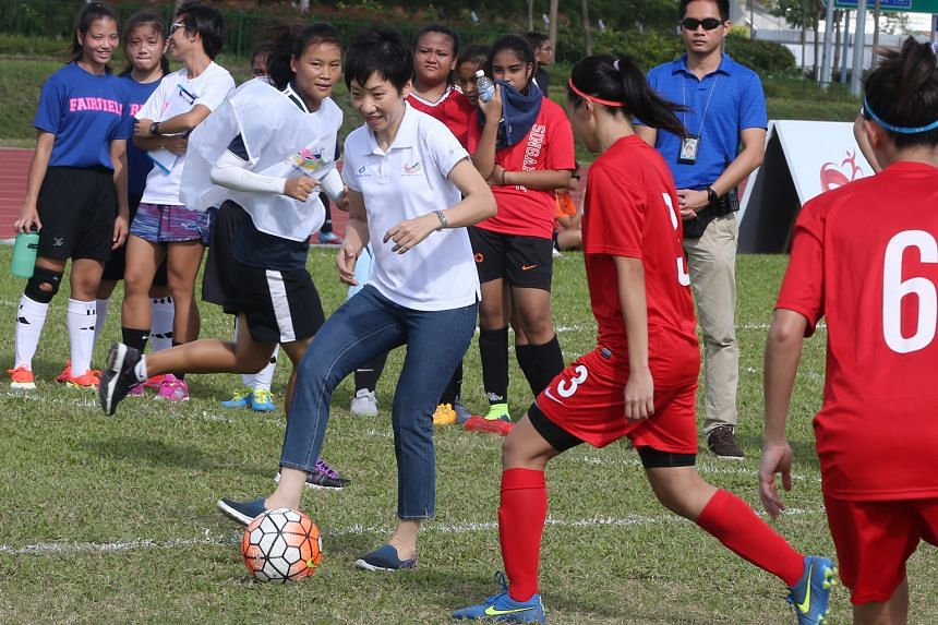 MCCY Minister Grace Fu (left) participating in an exhibition match between the women's national team and the management of the Football Association of Singapore and  Sport Singapore.