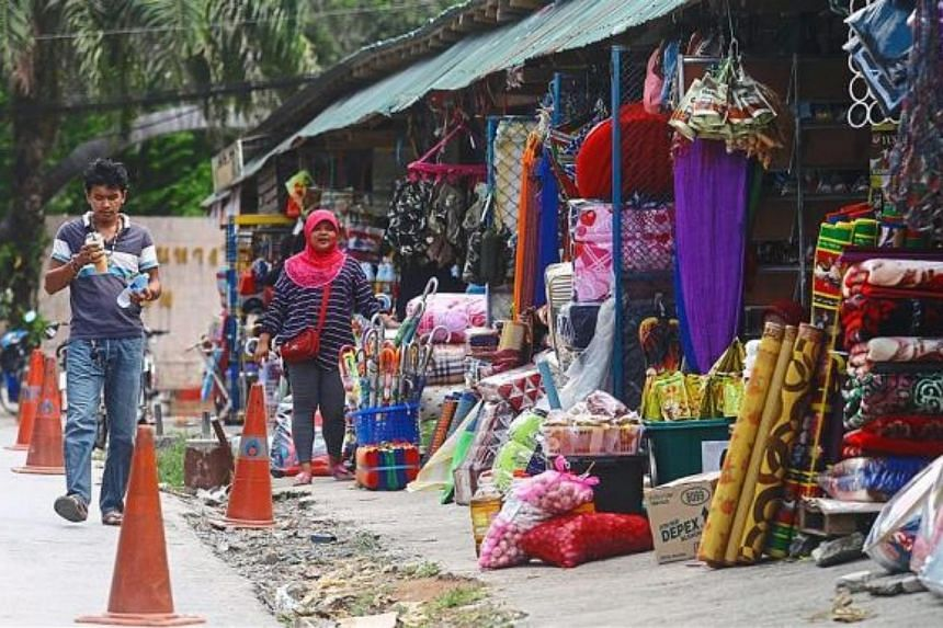 Traders waiting for customers at the Wang Prachan market in Satun, Thailand.