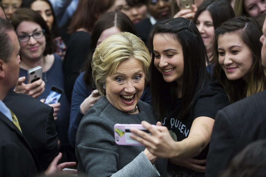 Hillary Clinton poses for a selfie with attendees to her campaign rally at George Mason University in Virginia on Feb 29, 2016.