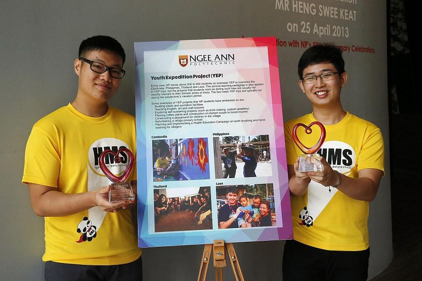 Social enterprise students Liew Yan Zhang (left) and Chong Yao Xiang designed a project in which needy people in Cambodia could use recycled cardboard to make educational tools which could be sold.