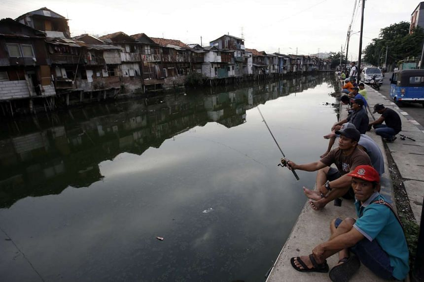 """Authorities hope the future resettlement of the affected squatters along the canals in Pluit will be another """"success story"""" like Kalijodo's eviction."""