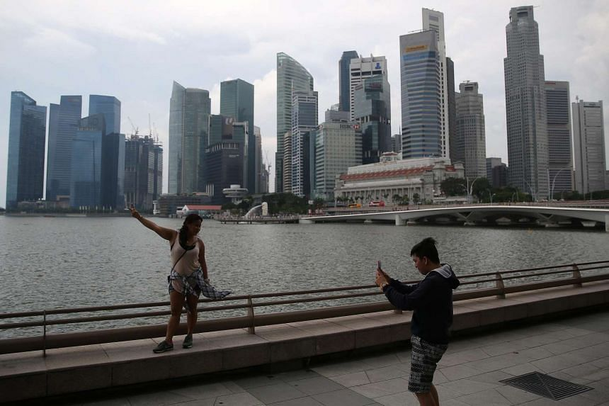 Tourists taking photos of themselves against the Singapore skyline on Jan 20, 2016.
