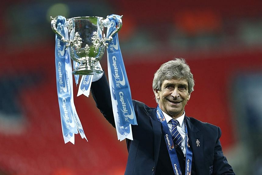 Manchester City manager Manuel Pellegrini (left) celebrates winning the League Cup against Liverpool and (above) dejected Reds player Philippe Coutinho is consoled after the shoot-out.
