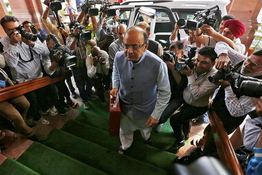 Mr Jaitley, India's Finance Minister, arriving at Parliament to present the Budget for the 2016/2017 fiscal year in New Delhi yesterday. He announced a big funding increase for the national rural employment guarantee scheme to $8 billion.