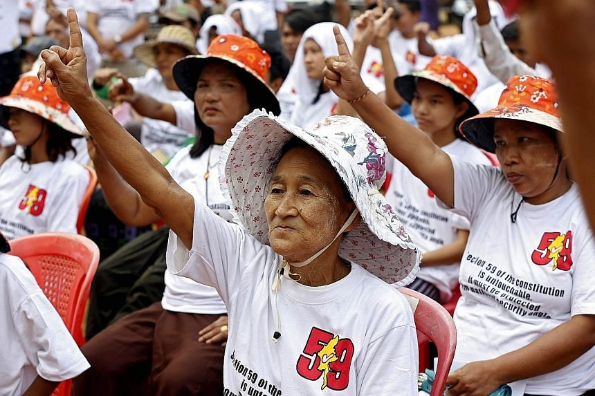 Hundreds of demonstrators in Yangon on Sunday protesting against tweaking Myanmar's Constitution to allow Ms Suu Kyi to become the next head of state.