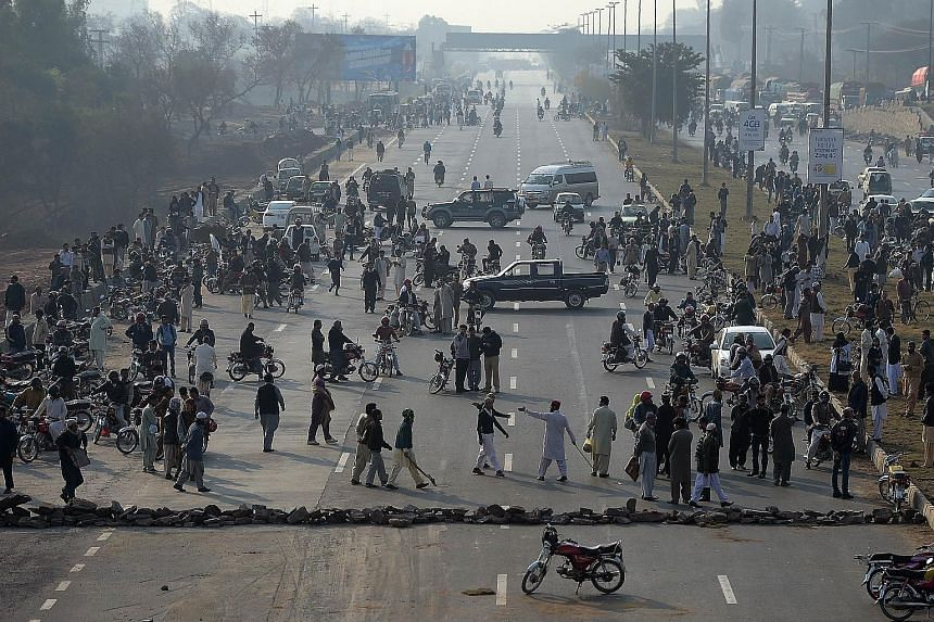 Supporters of Qadri blocking a highway in Islamabad during a protest against his execution yesterday. Qadri shot Punjab governor Salman Taseer 28 times in Islamabad in 2011 as the latter had championed the cause of a Christian woman sentenced to deat