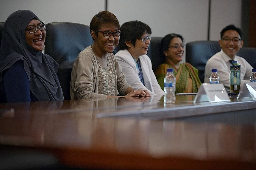At the media interview yesterday were (from left) Madam Rafidah and her daughter, Ms Siti, with three members of the team behind Singapore's first living paired kidney exchange transplant - Prof Yap Hui Kim, Prof A. Vathsala and Dr Tiong Ho Yee, seni
