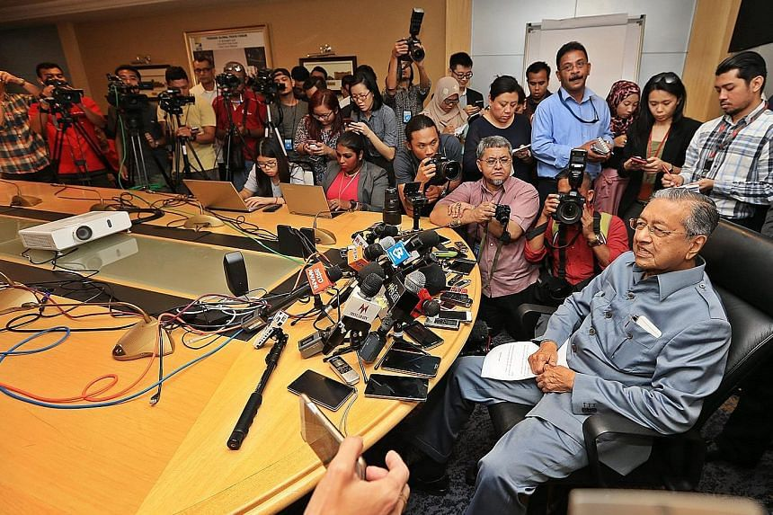 Dr Mahathir at a press conference yesterday. On top of giving the reasons for his resignation, he also finally abandoned his insistence that removing Mr Najib is all that is needed to reform Umno.