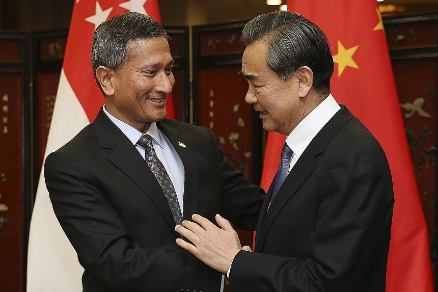 Foreign Minister Vivian Balakrishnan meeting his Chinese counterpart Wang Yi in Beijing yesterday. Dr Balakrishnan is on his first visit to China since becoming Foreign Minister on Oct 1 last year. He also met Vice-President Li Yuanchao yesterday.