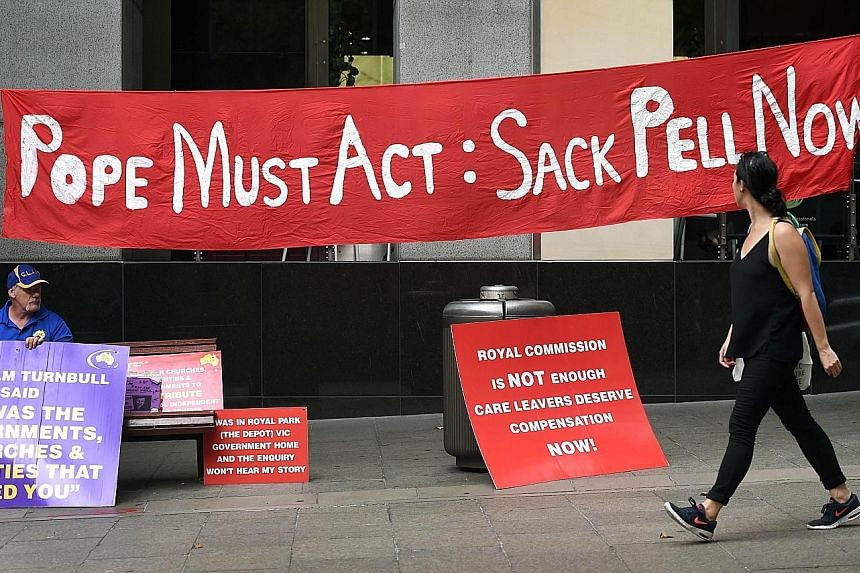 Protest signs outside a building where the Royal Commission into Institutional Responses to Child Sexual Abuse heard Cardinal Pell give evidence via video-link. The inquiry is currently focused on the Victorian state town of Ballarat, where the Cardi