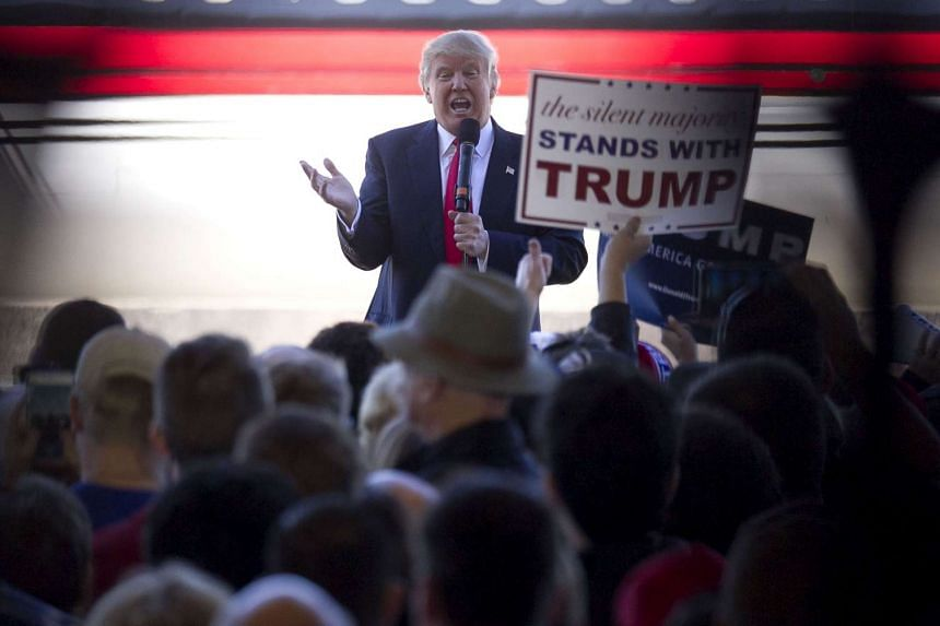Mr Donald Trump bashes Republican rival Marco Rubio as he talks to supporters at a campaign rally in an airplane hanger at Northwest Arkansas Regional Airport on Feb 27, 2016 in Bentonville, Arkansas. Georgians will vote on Super Tuesday on March 1
