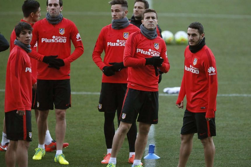 Atletico Madrid players attend a training session held at Vicente Calderon stadium, in Madrid, Spain, on Feb 29, 2016.