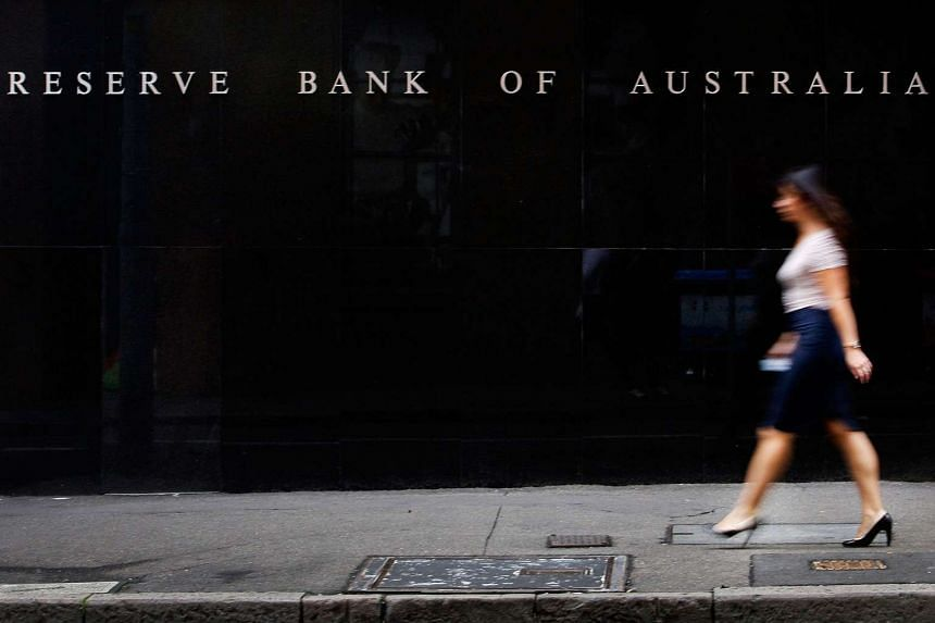 A pedestrian walks past the Reserve Bank of Australia in Sydney.