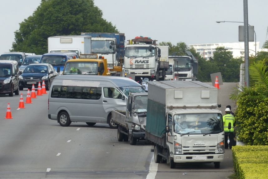 Three lorries and a minivan were involved in a crash on the Ayer Rajah Expressway on March 1, 2016.