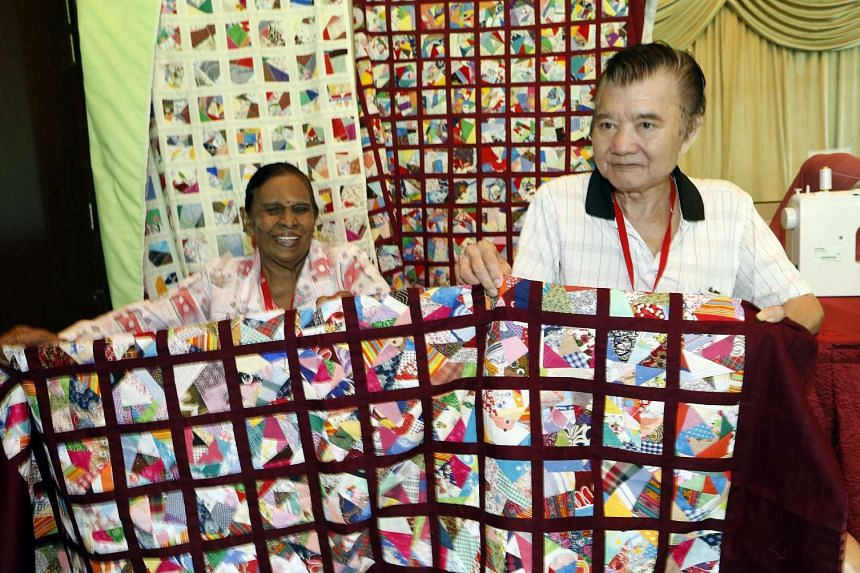 Ms Lachimee (left), a participant of the Weaving Love, Mending Hearts programme, presenting a quilt to Mr Ong Yu Seng on March 1, 2016.