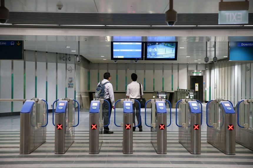 With the system, commuters can tap their credit cards in and out at train station fare gantries or on bus card readers.