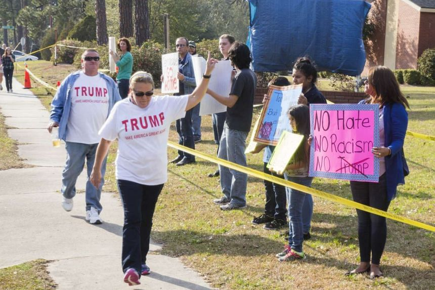 Supporters and protesters arriving at a rally for Republican presidential candidate Donald Trump at Valdosta State University Feb 29, 2016.