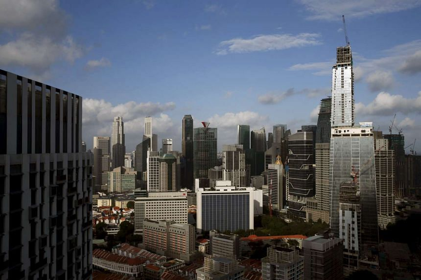 GuocoLand's Tanjong Pagar Centre (right), soon to be the tallest building in Singapore, towers over other buildings in the Central Business District.