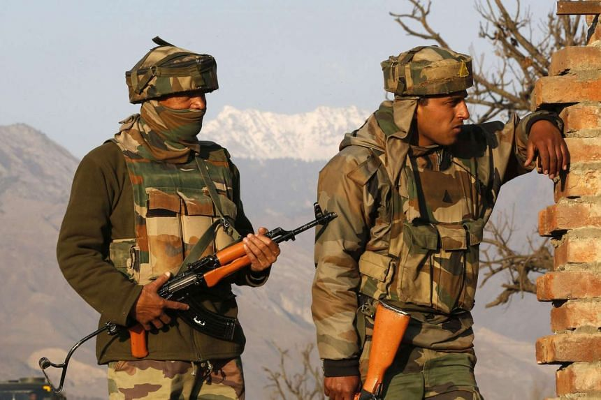 Indian Army soldiers stand guard near the site of a gunfight with militants near Kashmir.