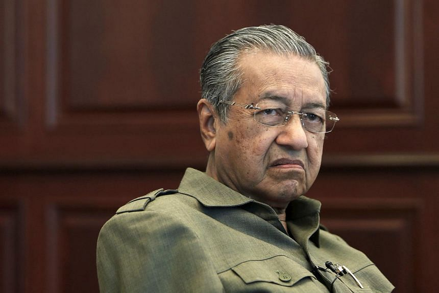 Former Malaysian prime minister Mahathir Mohamad is pictured during an interview at his office in Kuala Lumpur in this Oct 18, 2013, file photo.