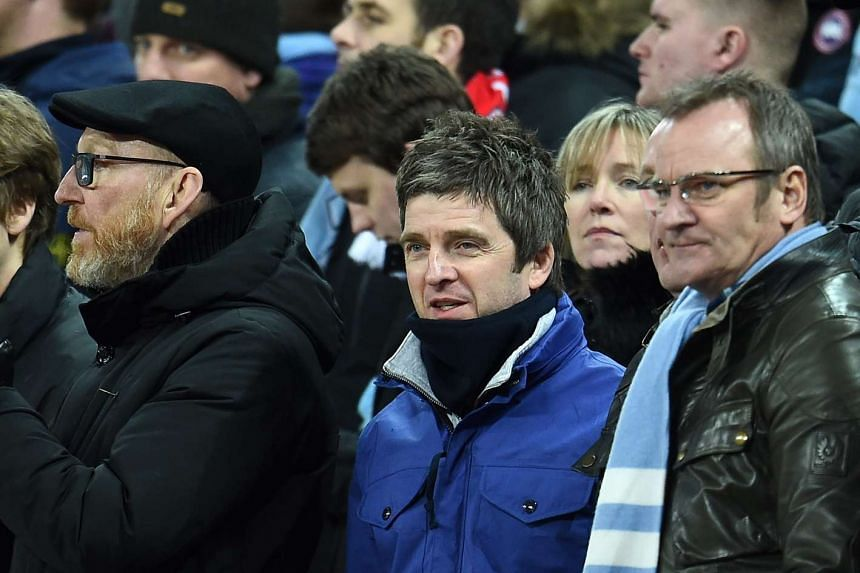 British musician Noel Gallagher (centre) watches Manchester City play against Liverpool, on Feb 28, 2016.