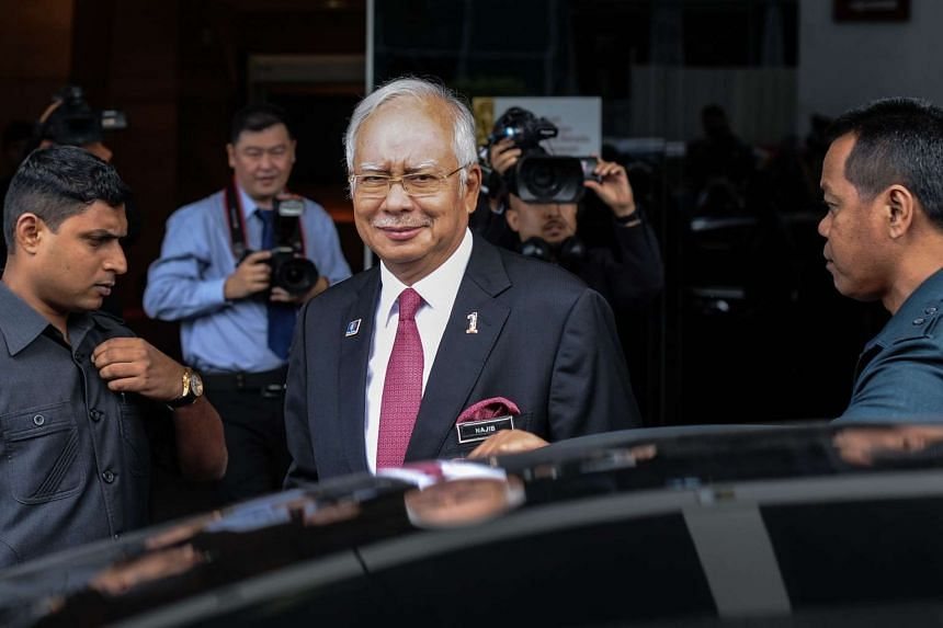 Malaysia's PM Najib Razak (centre) leaving after a parliamentary session in Kuala Lumpur on Jan 26, 2016.