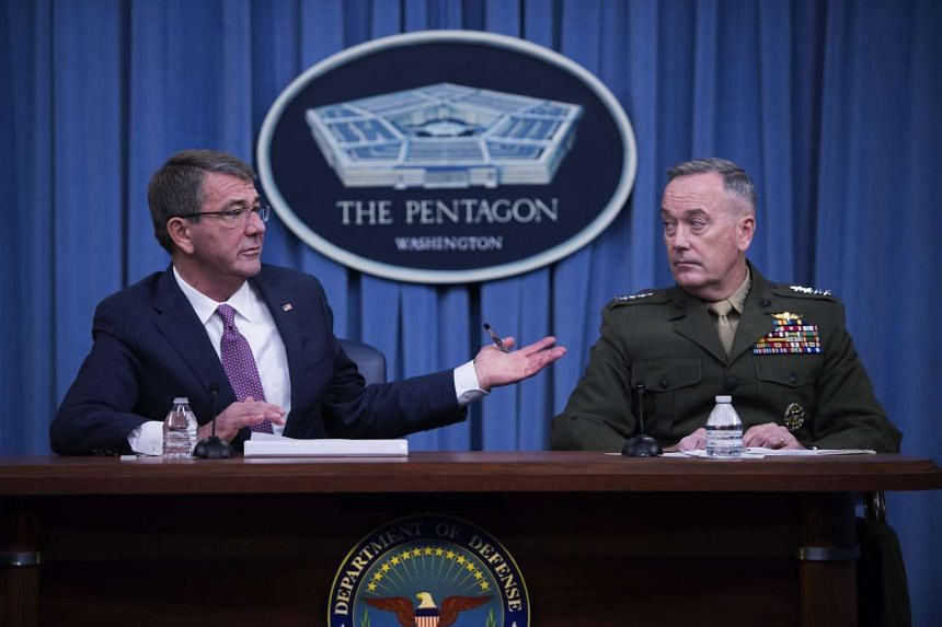 US Secretary of Defence Ashton Carter (left), with Chairman of the Joint Chiefs Marine General Joseph Dunford (right), responds to a question at the Pentagon on Monday (Feb 29).