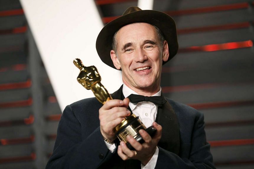 Actor Mark Rylance poses with his Best Supporting Actor award for his role in the film Bridge of Spies on Monday (Feb 29).