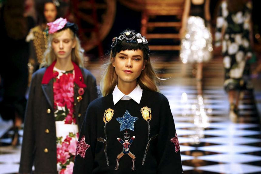 Models present creations from the Dolce & Gabbana Autumn/Winter 2016 woman collection during Milan Fashion Week in Italy.