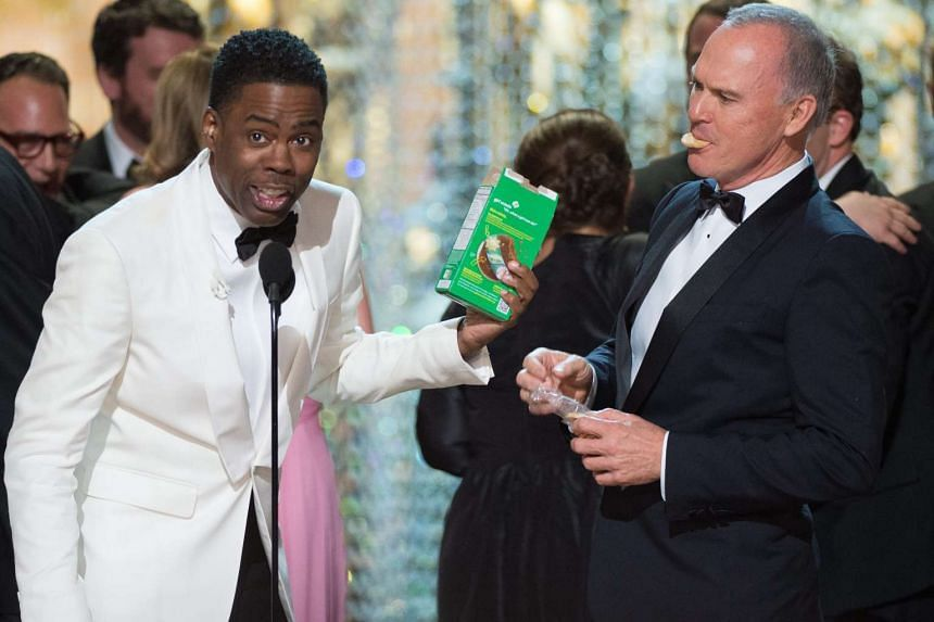 Oscars host Chris Rock (left) closes out the night with Michael Keaton during the live telecast of the 88th annual Academy Awards ceremony.