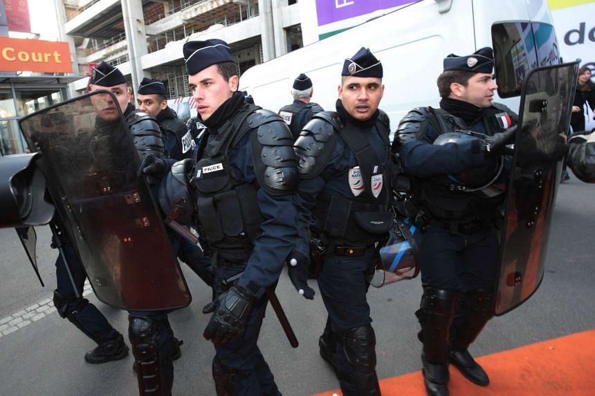 "Riot police officers deploy outside the ""Salon de l'Agriculture"" (Agriculture Fair) in Paris on the opening day over the weekend."