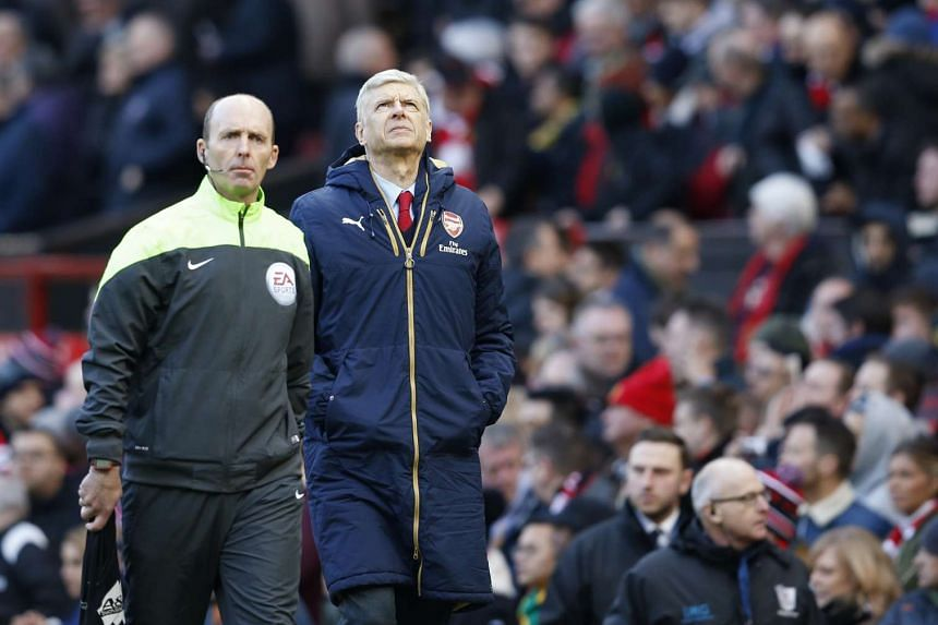 Arsene Wenger looks dejected after the match between Manchester United and Arsenal.