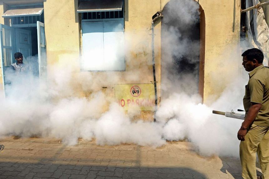 A municipal worker fumigates a residential area during a cleanliness drive in Mumbai on Feb 25, 2016.