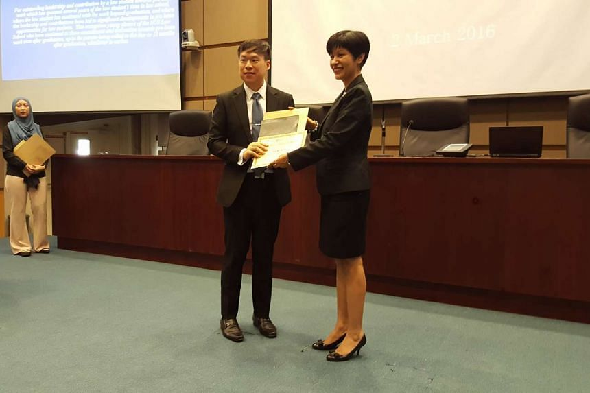 Mr Ng Bin Hong, winner of the Pro Bono Champion Award for his pro bono work in areas such as military justice, and Senior Minister of State for Law Indranee Rajah, at the award ceremony at the NUS law faculty.