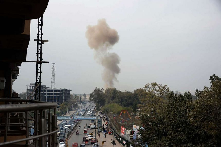 Smoke billows from the site of an attack in front of the Indian consulate in Jalalabad on March 2, 2016.